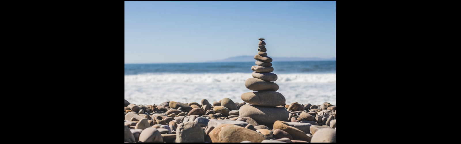 Mind - Meditation - Rocks Balanced in a Pile on the Beach