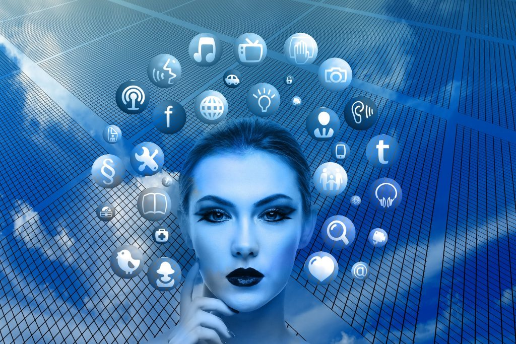 Social Media Specialist - Skyscraper mirroring the sky, woman's head (thinking pose) with social media icons circling her head