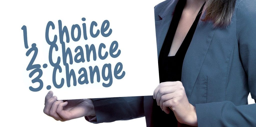 woman holding up a sign that says Choice, Chance, Change