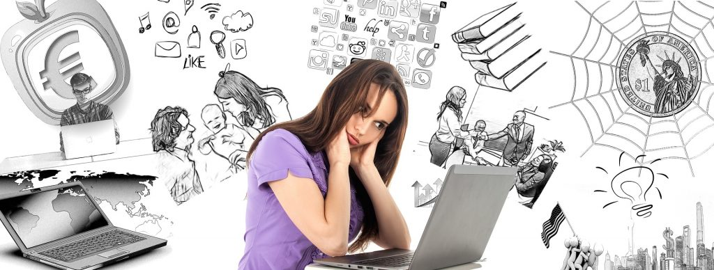 Frustrated woman staring at a computer screen and thinking about all the things she has to do for work and home. Stumbling blocks to building an online presence.